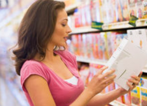 woman checking the label of a food product