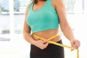 satisfied woman measuring her belly