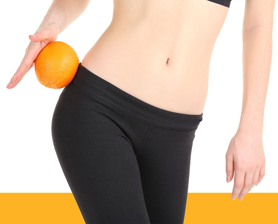 fit woman holding an orange
