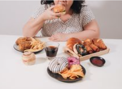 woman eating unhealthy foods