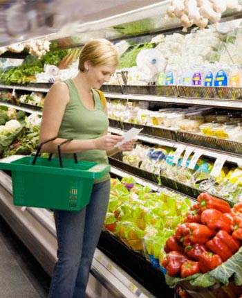 woman checking her food list on grocery