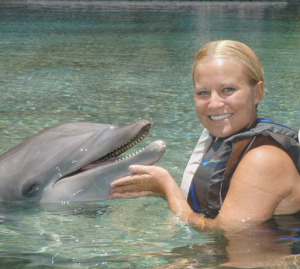Healthy woman with a Dolphin