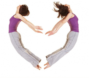 two sexy woman forming love sign